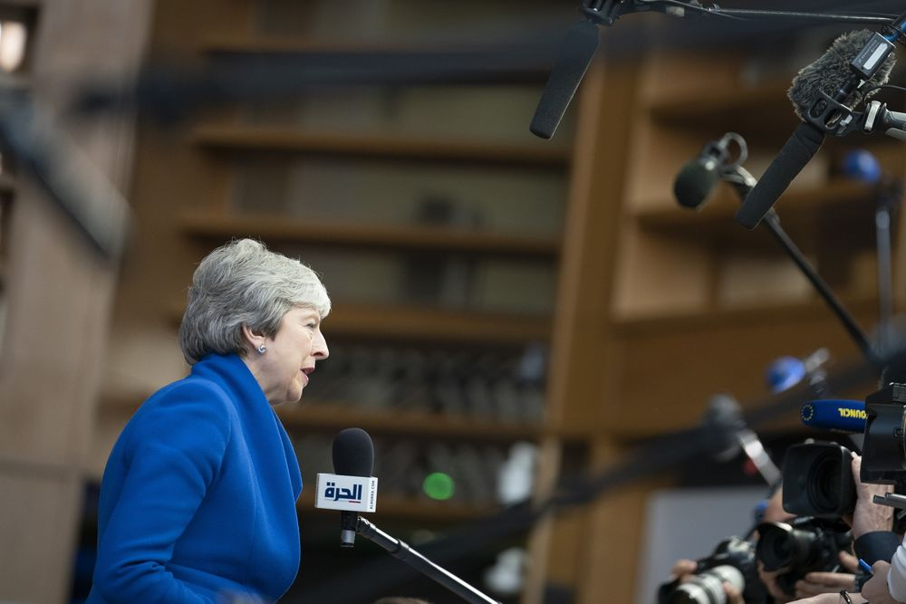 May Returns to Face Brexit Crisis as Leadership Pressure Grows