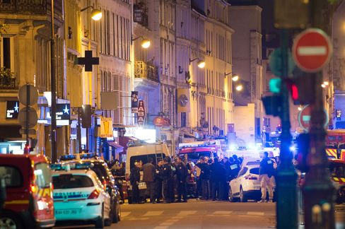 Officials investigate the scene outside the Bataclan concert hall