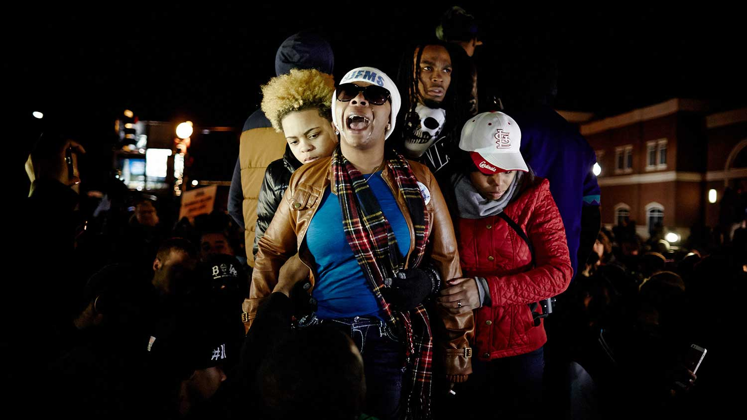 Michael Brown's mother, Lesley McSpadden, second from right, reacts outside the Ferguson police department on Monday.