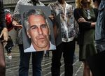 A protest group holds up signs of Jeffrey Epstein in front of the Federal courthouse in New York in2019.