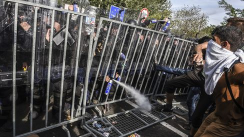 Hungarian police use pepper spray to push back refugees at the border with Serbia on Sept. 16.