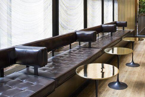 Custom bronze Tulip tables by Eero Saarinen
