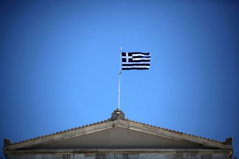 A Greek National Flag Flies above the Parliament Building