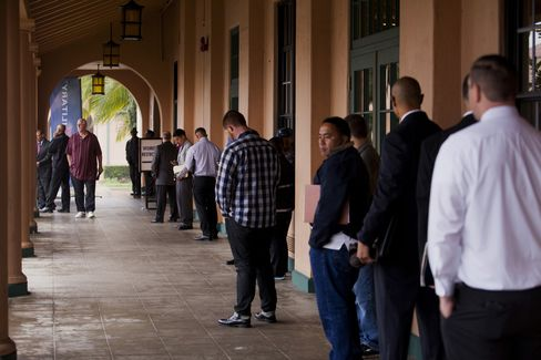 Job Seekers Line Up at a Job Fair