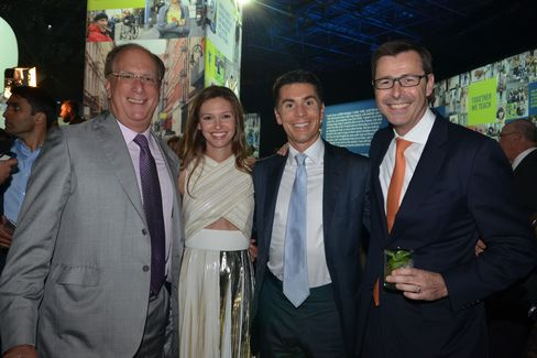 Larry Fink, Filipa Fink, Joshua Fink and Mark McCombe. Photographer: Amanda Gordon/Bloomberg