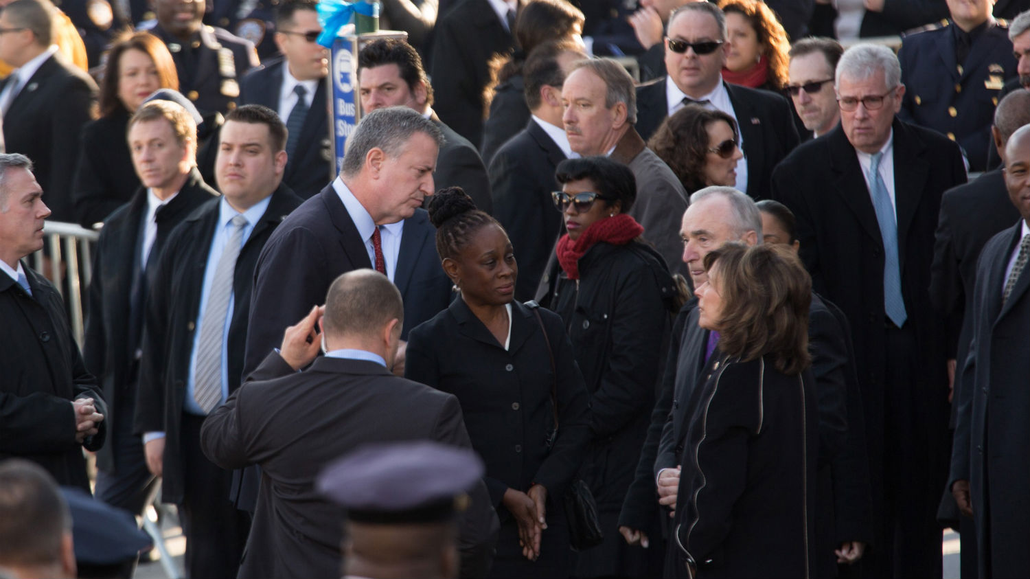 "New York Mayor Bill de Blasio and his wife, Chirlane McCray, greet Police Commissioner Bill Bratton and his wife, Rikki Klieman. ""All of this city is grieving and grieving for so many reasons, but the most personal is we've lost such a good man and a family is in such pain,"" de Blasio said during the service."