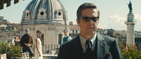 On a rooftop in Rome, Hugh Grant makes a cameo in Oliver Peoples sunglasses.