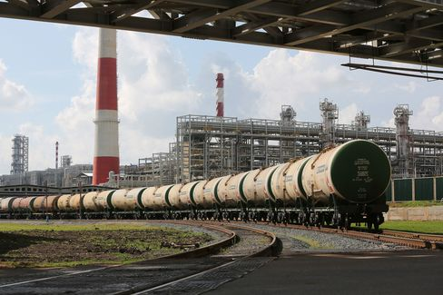 Freight cars filled with petroleum sit at a refining and petrochemical plant in Nizhenekamsk, Russia, on July 30, 2015.