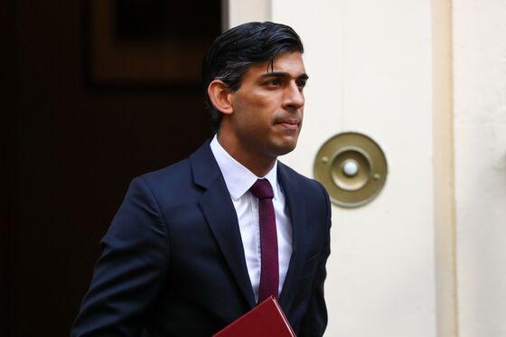 Sunak Starts U.K.'s Reckoning With Ruinous Legacy of Covid