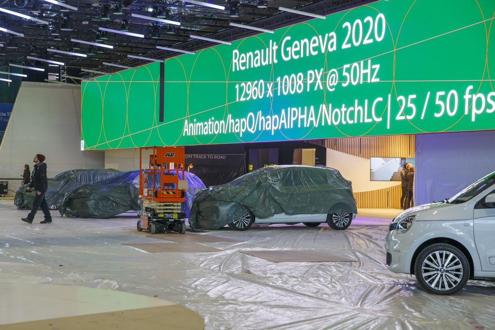 Workers stop preparations for the 90th Geneva International Motor Show on Feb. 28.