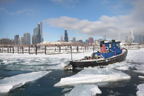 A Tugboat Breaks Up Ice in Chicago