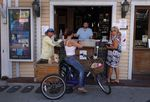 People order at the walkup window of a barin Key West, Floridaon March 25.