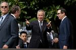 Liu He, China's vice premier, center, gestures while arriving for a meeting with Steven Mnuchin, U.S. Treasury secretary, right, and Robert Lighthizer, U.S. trade representative, second left, at the Office of the U.S. Trade Representative in Washington, D.C., U.S., on Thursday, Oct. 10.