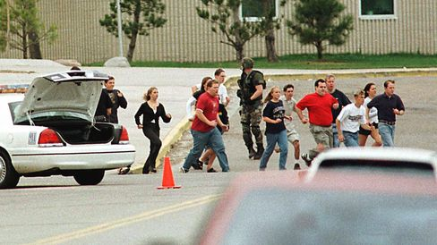 Students run from Columbine High School in this April 20, 1999 file photo in Littleton, Colorado, after two masked teens stormed the school and used guns and explosives on fellow students before turning the weapons on themselves.