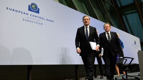 Mario Draghi, left, President of the European Central Bank, and vice president Vitor Constancio, right, leave the first press conference following the monthly ECB board meeting in the new ECB headquarters.