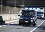 A Toyota Motor Corp. JPN Taxi vehicle is taken for a drive following its launch in Tokyo, Japan, on Monday, Oct. 23, 2017.