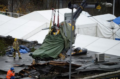 Police Helicopter Wreckage is Removed from the Clutha Vaults Pub