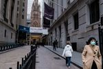 A pedestrian wearing a protective mask walks past the New York Stock Exchange (NYSE) in New York.