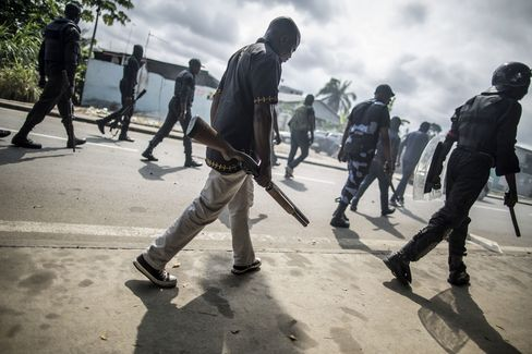 Gabonese police forces patrol the streets of Libreville on Sept. 1.