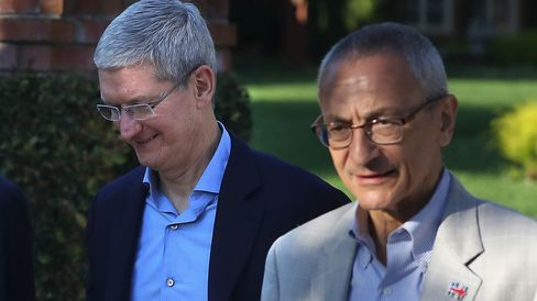 Apple CEO Tim Cook and Clinton campaign chairman John Podesta leave a fundraiser on Aug. 24, 2016, in Los Altos Hills, California.