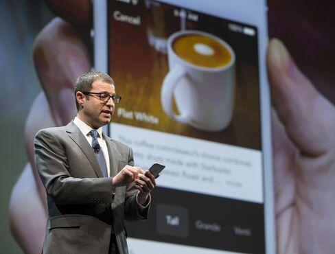Adam Brotman demonstrates Starbucks' mobile-ordering service.