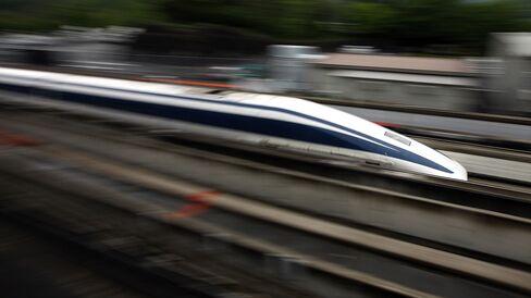 A magnetic-levitation (maglev) train passes at Central Japan Railway Co.'s Yamanashi Maglev test line, in Tsuru City, Yamanashi Prefecture, Japan.