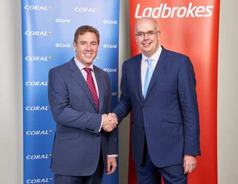 Gala Coral Group Ltd. CEO Carl Leaver, left, shakes hands with Ladbrokes Plc. CEO Jim Mullen in London. Photographer: Charles Shearn via Bloomberg