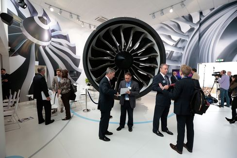 Visitors stand beside a GEnx next generation jet engine in the GE Aviation Systems LLC chalet on the opening day of the 51st International Paris Air Show in Paris, on June 15.
