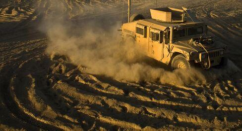 A US Army humvee maneuvers on a forward