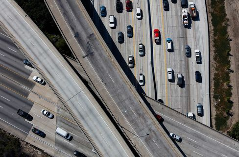Vehicles move along the Interstate 405 freeway during rush hour in Los Angeles, Calif.
