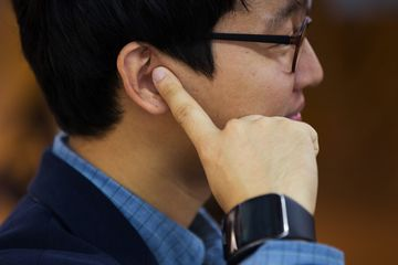 Choi Hyun Chul, chief executive officer of Innomdle Lab, poses for a photograph while wearing the prototype of the TipTalk device with his finger to his ear in Seoul, South Korea, on Friday, Oct. 23, 2015. Choi, a Samsung Electronics Co. engineer, developed a wristband that keeps eavesdroppers from listening to smartphone conversations. Photographer: SeongJoon Cho/Bloomberg
