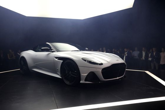 Aston Martin Revs Up Ferrari Chase With `Bruit in a Suit' DBS