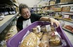 A volunteer unloads deliveries at a food bank that serves greater Des Moines, Iowa.