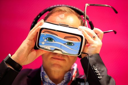 A delegate tries on a Samsung Gear VR headset at the Mobile World Congress in Barcelona.