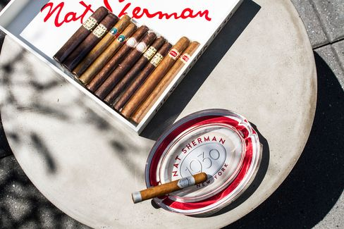 St. Cloud's Nat Sherman cigars are served atop industrial concrete tables in the outdoor cigar lounge.