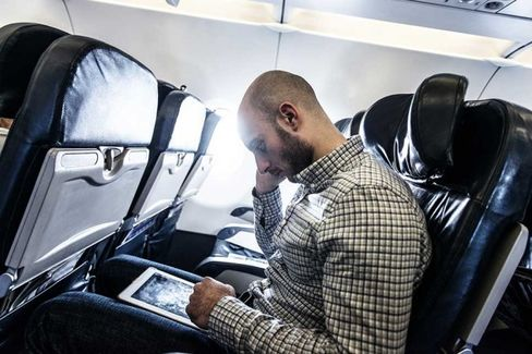 Airlines Need You (and Your Gadgets) to Kill Those Seat-Back Screens