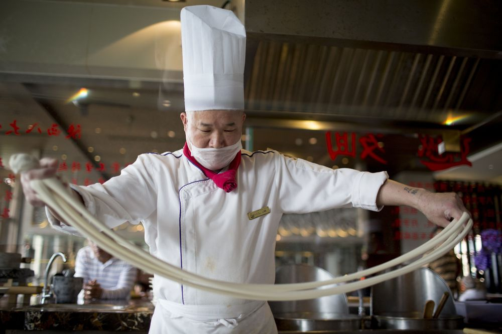 China Trains Chefs, Builds Ski Slopes to Cushion Slowing Growth