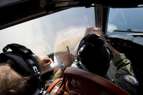 Flight Lieutenant Jayson Nichols looks at a map as he flies over the southern Indian Ocean in search of the missing Malaysian Airlines flight MH370.