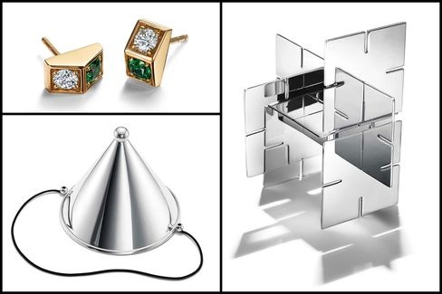 From top left, clockwise: Diamond tsavorite earrings in 19-karat gold, price upon request; desk puzzle in sterling silver, $500; party hat in sterling silver, $1,000.