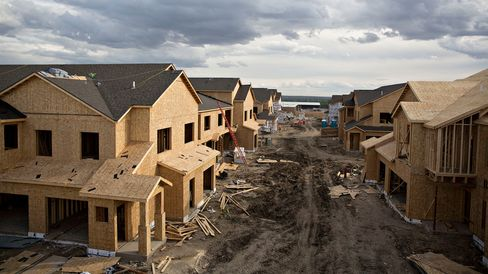 Partially completed buildings stand during construction at the Williston Apartments luxury apartment complex in Williston, North Dakota, on Sept. 9, 2015.