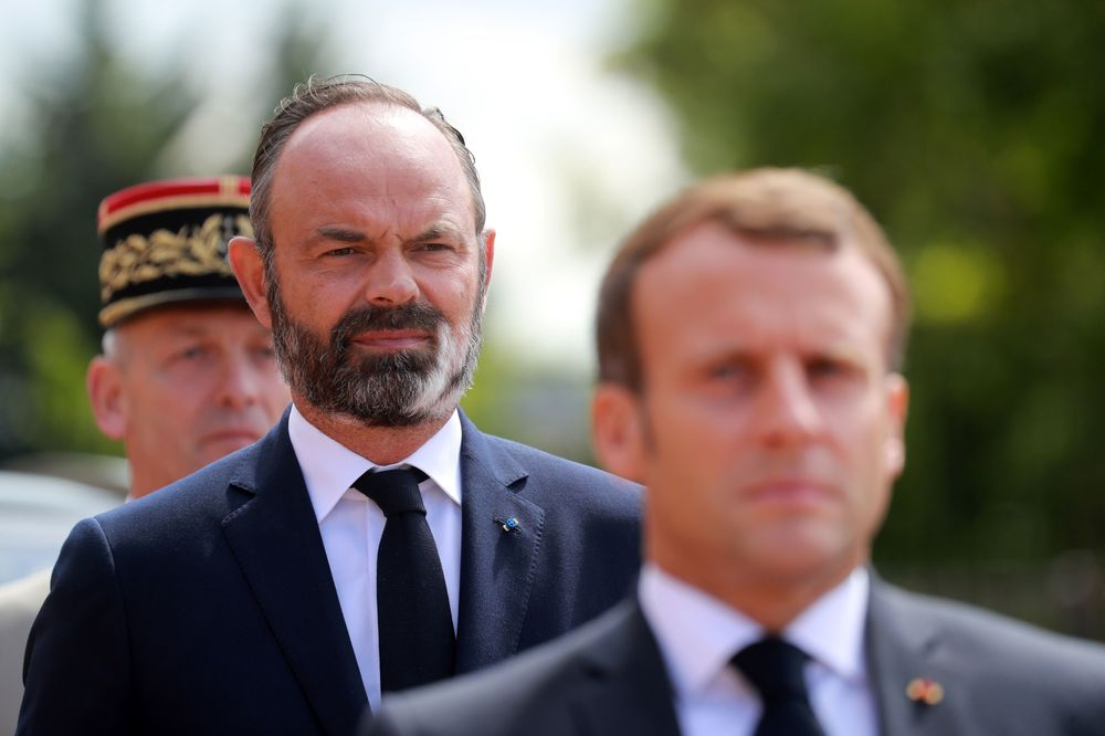 Edouard Philippe, left, andEmmanuel Macron, at a French memorial in Suresnes, France, on June 18.