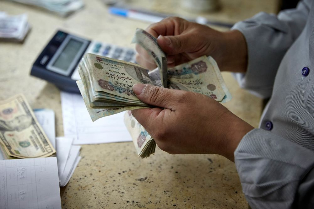 A Man Counts Egyptian Pounds Banknotes At Foreign Currency Exchange Bureau In Cairo Egypt