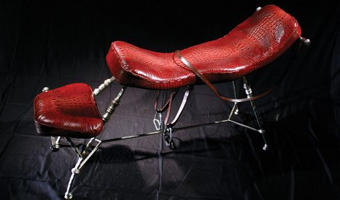 The Tally Ho Chair by Mark Brazier-Jones, here seen in crocodile leather. In the movie it was covered in velvet.