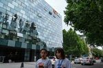 Pedestrians walk past the Didi Global Inc. headquarters in Beijing, China, on Monday, July 5, 2021.