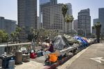 Homeless residents of Los Angeles live in tents along Interstate 110.