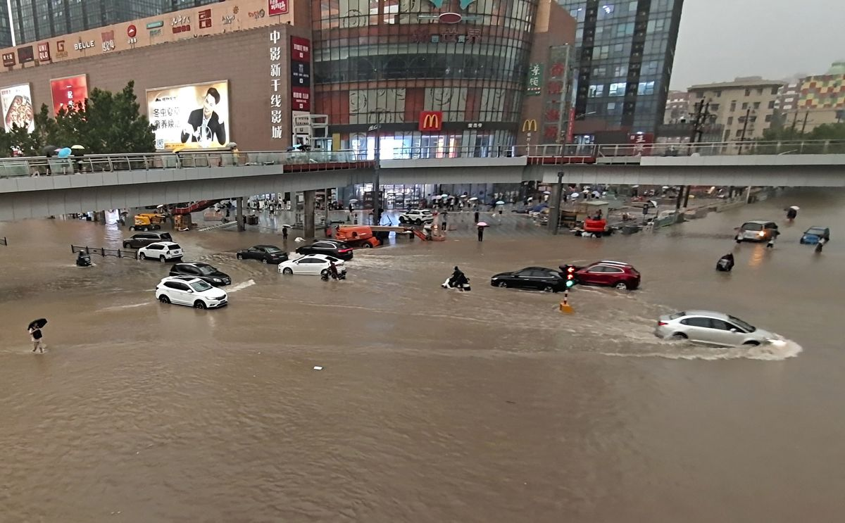 China's 'iPhone City' Relocates 100,000 After Floods Leave 12 Dead thumbnail
