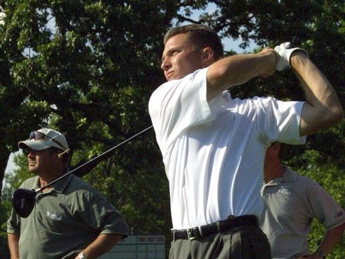 Trip Kuehne tees off during a practice round at the Olympia Fields Country Club in Illlinois, in 2003.