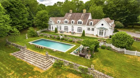 The seven-bedroom house sits on 10 acres.