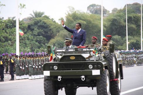 Congolese President Denis Sassou Nguesso inspects his troops before a parade to mark Congo's Independence Day in Kinkala, Republic of Congo, on August 15, 2012.