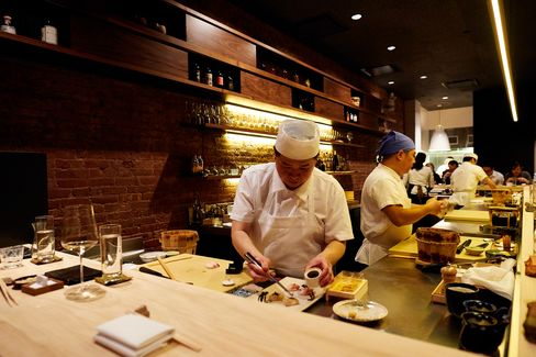 The best seats in the house are along the bar, where you can watch the cooks slice fish and spin nigiri.
